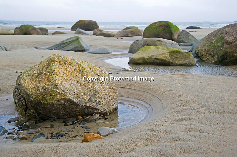 Rocks and Boulders on a Misty Beach in Wells along the Coast of Maine