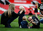 Clay Rooney looks after a young child as the children of the Manchester Utd players have a run out during the English Premier League match at the Old Trafford Stadium, Manchester. Picture date: May 21st 2017. Pic credit should read: Simon Bellis/Sportimage