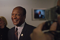 Illinois Secretary of State Jesse White on his way to meet with the new Illinois Governor Pat Quinn on his first day at the Thompson Center in Chicago, Illinois on January 30, 2009.  The day before, the Illinois state senate voted to impeach Quinn's predecessor, Rod Blagojevich; White refused to sign the authorization for Blagojevich's Senate appointment of Roland Burris.
