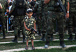 A Palestinian boy wears the al-Qassam Brigades costume during a military parade marking the first anniversary of the killing of Hamas's military commanders Mohammed Abu Shamala and Raed al-Attar, in Rafah in the southern Gaza Strip on August 21, 2015. Abu Shammala and al-Attar were killed by an Israeli air strike during the 50-day war between Israel and Hamas militants in the summer of 2014. Photo by Abed Rahim Khatib