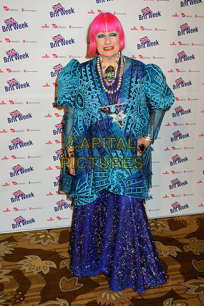 """ZHANDRA RHODES .BritWeek 2010 Charity Event: """"Save The Children and Virgin Unite"""" held at the Beverly Wilshire Hotel, Beverly Hills, California, USA, 22nd April 2010..full length long maxi dress purple jacket skirt puff sleeves sleeve pink dyed hair fringe blue eyeliner make-upbeads necklaces necklace turquoise print red lipstick puffy pattern .CAP/ADM/BP.©Byron Purvis/AdMedia/Capital Pictures."""