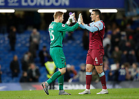 30th November 2019; Stamford Bridge, London, England; English Premier League Football, Chelsea versus West Ham United; Goalkeeper David Martin of West Ham United celebrates with Fabian Balbuena of West Ham United after full time as West Ham United beat Chelsea 0-1 at Stamford Bridge  - Strictly Editorial Use Only. No use with unauthorized audio, video, data, fixture lists, club/league logos or 'live' services. Online in-match use limited to 120 images, no video emulation. No use in betting, games or single club/league/player publications