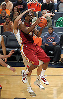 Dec. 30, 2010; Charlottesville, VA, USA; Iowa State Cyclones guard Darion 'Jake' Anderson (5) is defended by Virginia Cavaliers forward Will Sherrill (22) during the game at the John Paul Jones Arena. Iowa State Cyclones won 60-47. Mandatory Credit: Andrew Shurtleff