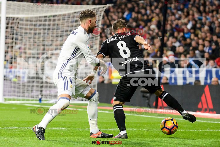 Real Madrid Sergio Ramos and Deportivo de la Coruña Emre Colak during La Liga match between Real Madrid and Deportivo de la Coruña at Santiago Bernabeu Stadium in Madrid, Spain. December 10, 2016. (ALTERPHOTOS/BorjaB.Hojas) /NORTEPHOTO.COM