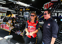 Apr 22, 2017; Baytown, TX, USA; Papa John's pizza founder and NHRA sponsor John Schnatter (right) talks with driver Leah Pritchett during qualifying for the Springnationals at Royal Purple Raceway. Mandatory Credit: Mark J. Rebilas-USA TODAY Sports