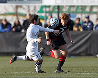 Northeastern University defender Jonathan Eckford (6) clears the ball as University of Connecticut midfielder Adria Beso (11) closes..NCAA Tournament. University of Connecticut (white) defeated Northeastern University (black), 1-0, at Morrone Stadium at University of Connecticut on November 18, 2012.