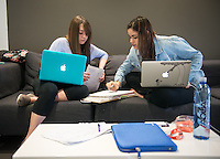 Occidental College students, from left, Jayci Reid '16 and Kira Schreiber '17, study for finals on Dec. 11, 2013 in the Rose Hills Foundation Student Activities Center in the Johnson Student Center (JSC.) (Photo by Marc Campos, Occidental College Photographer)
