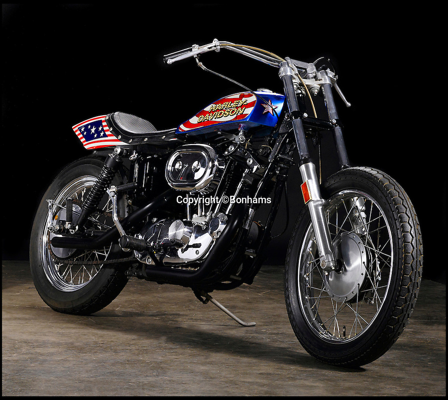 BNPS.co.uk (01202 558833)<br /> Pic: Bonhams/BNPS<br /> <br /> A classic Harley-Davidson motorbike ridden by Hollywood daredevil Evel Knievel in his first and only film has gone on sale for more than £60,000.<br /> <br /> Knievel, considered one of the greatest showmen of the 20th century, rode the 1976 custom-built Harley in 1977's Viva Knievel!, a fictional adventure film in which he played himself.<br /> <br /> Stuntman Knievel topped a star-studded cast that included Gene Kelly, Lauren Hutton, Leslie Neilsen and Red Buttons, but the mechanical stars were several Harley-Davidson XL1000 that had been painted in Knievel's Stars and Stripes livery to make them look like one of his iconic jump bikes.<br /> <br /> One is now tipped to fetch $100,000 - around £66,000 - when it goes under the hammer at Bonhams auctioneers.