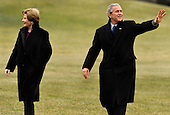 Washington, DC - January 18, 2009 -- United States President George W. Bush (R) waves as he and first lady Laura Bush return to the White House in Washington from a weekend at the presidential retreat at Camp David, 18 January 2009.  Bush, on his last sheduled flight on Marine One, returned to a frigid Washington, that despite the temperatures, is caught up in a swirl of inauguration activities for President-elect Barack Obama on 20 January.    .Credit: Mike Theiler - Pool via CNP