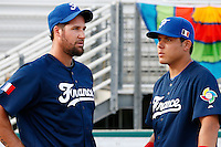 20 September 2012: Eric Gagne talks to Team France captain Boris Marche prior to Spain 8-0 win over France, at the 2012 World Baseball Classic Qualifier round, in Jupiter, Florida, USA.