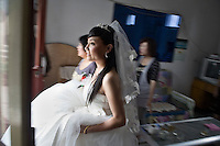Bride-to-be Ren Jing and her friends prepare for her wedding in Pingliang, Gansu, China.  Ren Jing is a member of the Hui ethnic minority, a Muslim minority native to northwestern China.