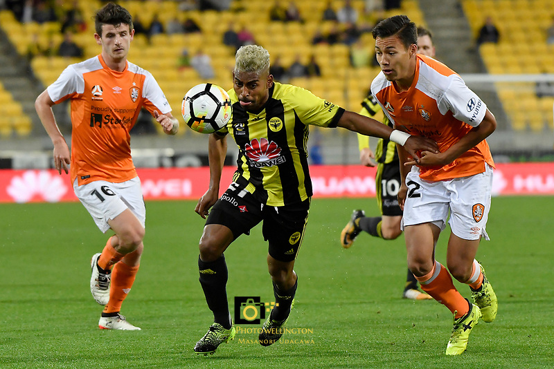 Wellington Phoenix&rsquo; Roy Krishna and Brisbane&rsquo;s Dane Caletti in action during the A League - Wellington Phoenix v Brisbane Roar FC at Westpac Stadium, Wellington, New Zealand on Saturday 28 October.<br /> Photo by Masanori Udagawa. <br /> www.photowellington.photoshelter.com