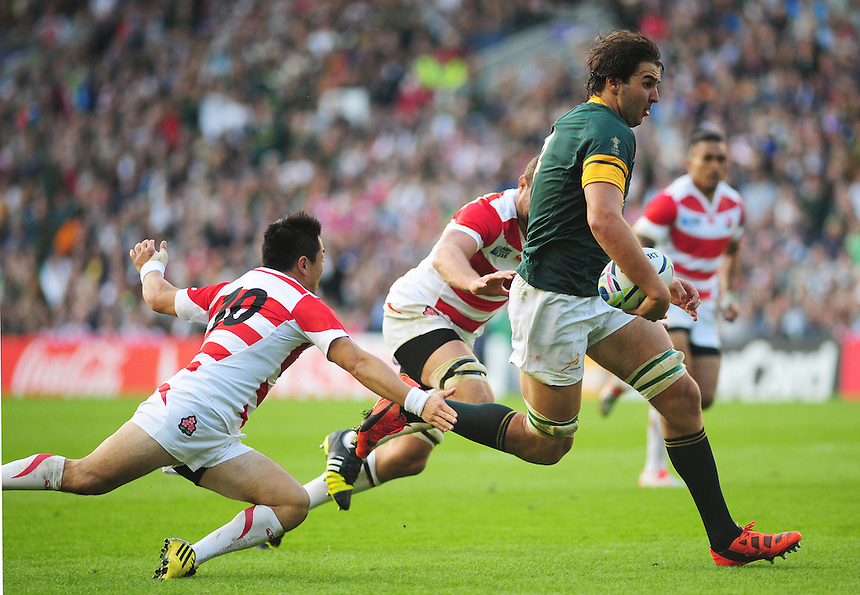 South Africa's Lood de Jager evades the tackle of Japan's Kosei Ono in the run up to scoring his sides third try<br /> <br /> Photographer Kevin Barnes/CameraSport<br /> <br /> Rugby Union - 2015 Rugby World Cup - Japan v South Africa - Saturday 19th September 2015 - The American Express Community Stadium - Falmer - Brighton<br /> <br /> &copy; CameraSport - 43 Linden Ave. Countesthorpe. Leicester. England. LE8 5PG - Tel: +44 (0) 116 277 4147 - admin@camerasport.com - www.camerasport.com