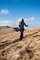 Female hiker hiking small trail towards Fan Y Big, Brecon Beacons national park, Wales