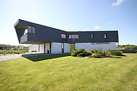 BNPS.co.uk (01202 558833)<br /> Pic:Phillips&Stubbs/BNPS<br /> <br /> A 'Grand Designs' style cantilevered property offering stunning views of the English Channel has emerged on the market for £2.35million. <br /> <br /> Warrenders, nestled in the village of Fairlight, sits atop a hill on the East Sussex coast in an Area of Outstanding Natural Beauty.<br /> <br /> It is surrounded by wooded valleys and a wildflower meadow, and looks out on Rye Bay.<br /> <br /> On a clear day, it is possible to see France from the ultra-modern three bedroom home, which was built between 2012 and 2014.<br /> <br /> The property, built on the site of an old farm, has a timber and steel superstructure, with the upper level clad in Spanish slate.