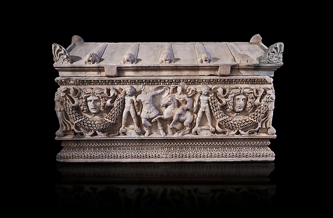 Side panel of a Roman relief garland  sculpted sarcophagus, style typical of Pamphylia, 3rd Century AD, Konya Archaeological Museum, Turkey. Against a black background