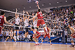 07 MAY 2016: Nicolas Szerszen (9) of Ohio State University attempts to tap the ball over several Brigham Young University defenders during the Division I Men's Volleyball Championship held at Rec Hall on the Penn State University campus in University Park, PA.  Ohio State defeated BYU 3-1 for the national title.  Ben Solomon/NCAA Photos
