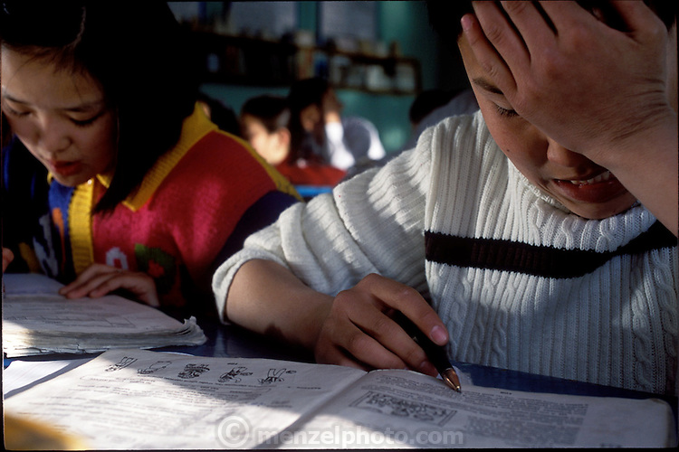Batbileg Batsuuri (right) battles with his reading in his Russian class at school. (Supporting image from the project Hungry Planet: What the World Eats.) The Batsuuri family of Ulaanbaatar, Mongolia, is one of the thirty families featured, with a weeks' worth of food, in the book Hungry Planet: What the World Eats.