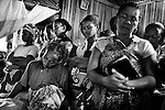 """MADAGASCAR, AMBANJA, MARCH 2013: <br />Radison Bienvenue, chief of security of the CINA cocoa plantation, was Murder the 12th of March 2013, the whole village tight around his wife at his funeral.<br />Madagascar is home to some of the world's finest rich orange and red pods of cocoa, increasingly used today by Europe and America's finest chocolatiers.Raw cocoa beans, used to make premium chocolate, have never been in higher demand. A surge in appetite for high-end chocolate sourced from single-origin growers has created a frenzied rush for the """"dark gold"""".<br /> For the island's cocoa farmers, the surging demand for chocolate should be transformative, especially after years of poverty, but their newfound livelihoods are under threat from armed bandits running rampant in remote areas, hijacking stores and road shipments of the precious beans that make chocolate. © Giulio Di Sturco"""
