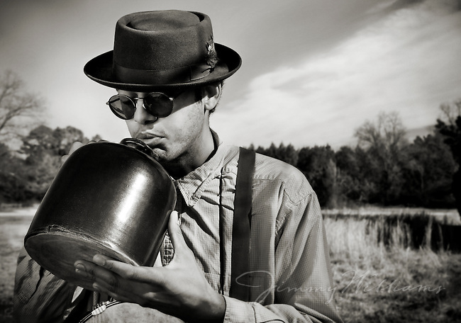 Don Flemons from the Carolina Chocolate Drops playing a jug