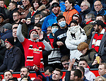 Fans wearing face mask in the crowd during the Premier League match at Old Trafford, Manchester. Picture date: 8th March 2020. Picture credit should read: Darren Staples/Sportimage