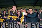 Maurice O'Donoghue hands over the O'Donoghue Cup to Dr Crokes captain Eoin Brosnan, after their victory over Gneeveguilla in the O'Donoghue Cup final in the Fitzgerald Stadium, Killarney on Sunday.