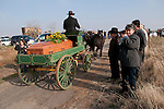 "A horse-drawn wagon takes the coffin and remains of the late Gale ""Slick"" Slicton to the hill-top Milton cemetery for his final trip on a dreary winter day, Milton, Calif."