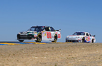 Jun. 21, 2009; Sonoma, CA, USA; NASCAR Sprint Cup Series driver Dale Earnhardt Jr (88) leads Bobby Labonte during the SaveMart 350 at Infineon Raceway. Mandatory Credit: Mark J. Rebilas-
