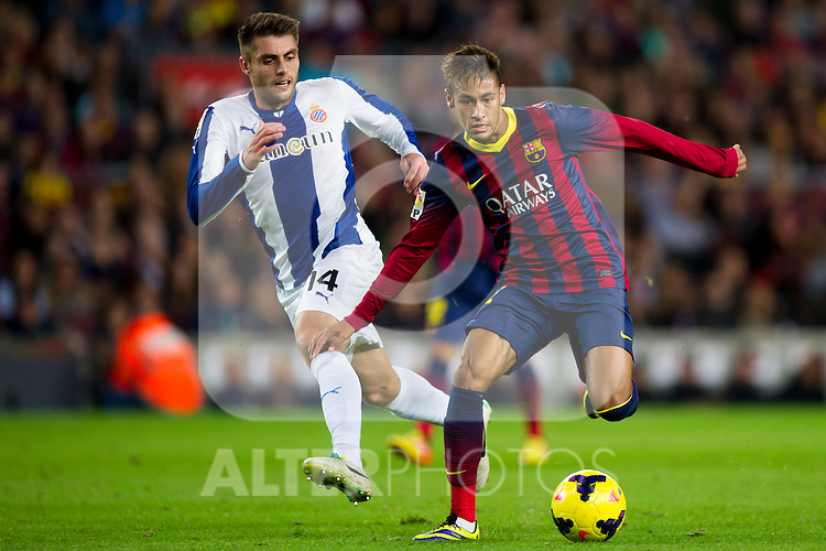 FC Barcelona's Neymar Santos Jr (right) and RCD Espanyol's David Lopez (left) during La Liga 2013-2014 match. November 1, 2013. (ALTERPHOTOS/Alex Caparros)