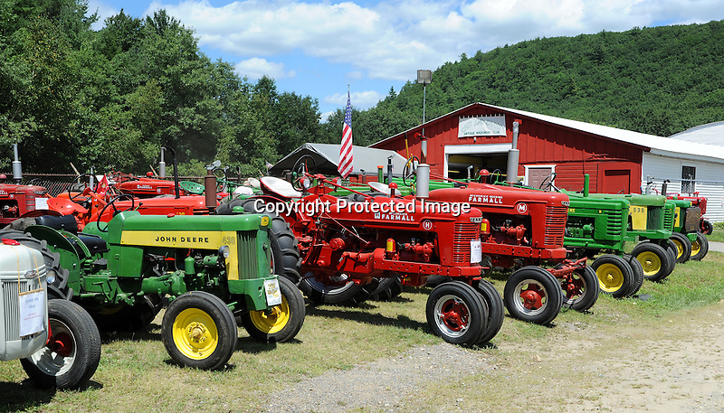 Antique farm tractor lineup at Cheshire Fair in Swanzey, New Hampshire USA