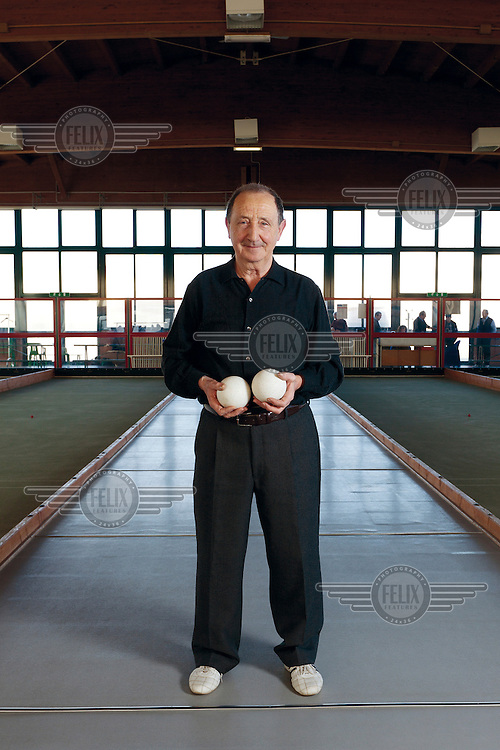 A elderly man in a Bocce hall in the small provincial town of Funo...