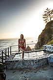USA, California, Big Sur, Esalen, a woman gets out of the Baths with the Pacifc Ocean in the distance, the Esalen Institute