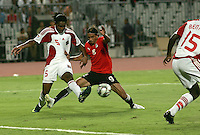 Egypt's Mohamed Talaat battles Trinidad & Tobago's Akeem Adams during the first half of the FIFA Under 20 World Cup Group A Match between Trinidad & Tobago at the Egyptian Army Stadium on September 24, 2009 in Alexandria, Egypt.