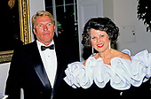Roland and Mary Ann Martin of Clewiston, Florida arrive at the White House in Washington, DC for the State Dinner in honor of President Patricio Aylwin of the Republic of Chile on Wednesday, May 13, 1992. Roland is a fishing pal of United States President George H.W. Bush.<br /> Credit: Ron Sachs / CNP