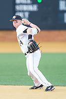 Wake Forest Demon Deacons shortstop Conor Keniry (14) makes a throw to first base against the Duke Blue Devils at Wake Forest Baseball Park on April 25, 2014 in Winston-Salem, North Carolina.  The Blue Devils defeated the Demon Deacons 5-2.  (Brian Westerholt/Four Seam Images)