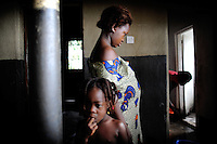 Isattu Jalloh, 11, is 7 months pregnant. The grassroot organization Amazonian Initiative movement has taken her out of her village near Lunsar, Sierra Leone, to arrange for her C-section in the government hospital. The girl was raped by her uncle. She would not have survived an unassisted birth, say the doctors, as her perineum is far too small for a baby to pass through.
