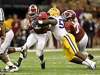 Anthony Johnson of LSU tackles Eddie Lacy of Alabama during BCS National Championship game at Mercedes-Benz Superdome in New Orleans, Louisiana on January 9th, 2012.   Alabama defeated LSU, 21-0.