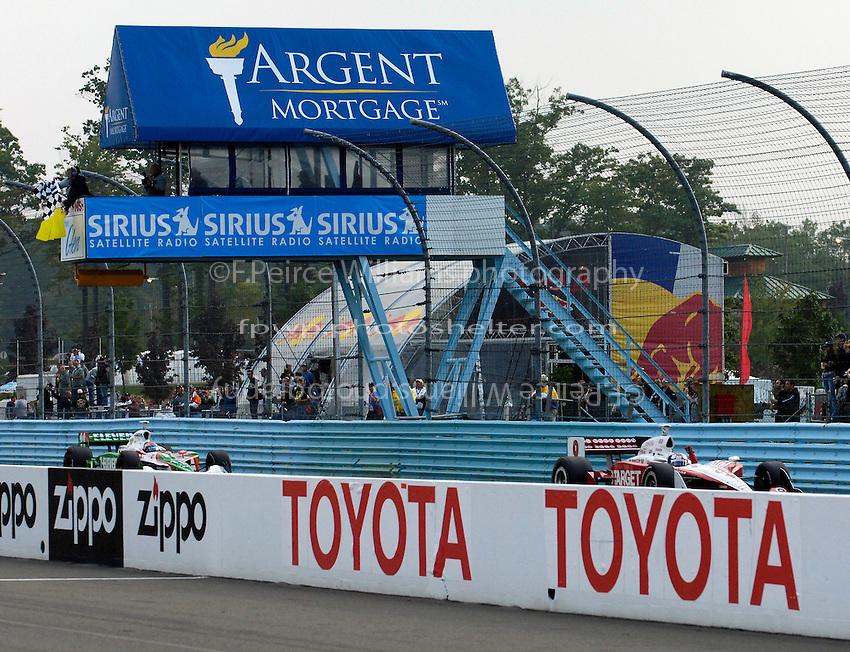 23-25 September,2005, Watkins Glen,New York USA.Winner Scott Dixon takes the checkered flag ahead of Tony Kanaan..Copyright©F.Peirce Williams 2005.
