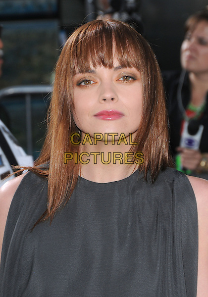 """CHRISTINA RICCI.The Universal Pictures' L.A. Premiere of """"Bruno"""" held at the Grauman's Chinese Theatre in Hollywood, California, USA. .June 25th, 2009.headshot portrait sleeveless fringe bangs grey gray .CAP/DVS.©Debbie VanStory/Capital Pictures."""