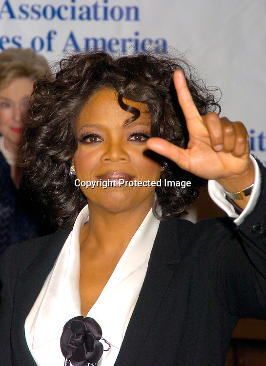 Oprah Winfrey ..at the United Nations Association of the USA Global Leadership Awards Dinner on September 30, 2004 at the ..Waldorf Astoria. Oprah Winfrey was honored with the ..International Philanthropist, Global Media Leader. ..Photo by Robin Platzer, Twin Images