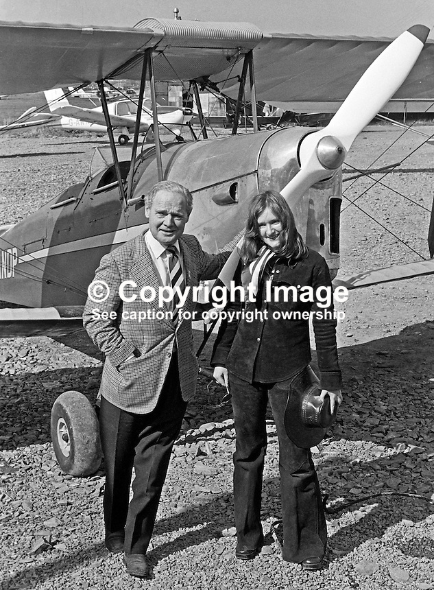 Wartime flying hero Group Captain Douglas Bader, at Newtownards Airfield, N Ireland, to declare open the Ulster Flying Club's new clubhouse pictured in front of a Tiger Moth with club member, Jane Galloway, 20 years, from Holywood, Co Down. 197504750356DB1.<br />
