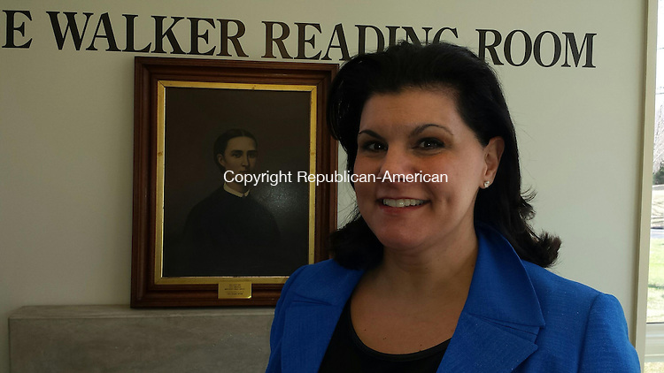 MIDDLEBURY, CT: 15 April 2015: 041515BB01: MIDDLEBURY --- Middlebury Public Library Director Jo-Ann LoRusso stands before a portrait of Mary Hine, who became the library's first director in 1896. LoRusso is taking a significant role in a national initiative for the future of libraries. Bill Bittar Republican-American