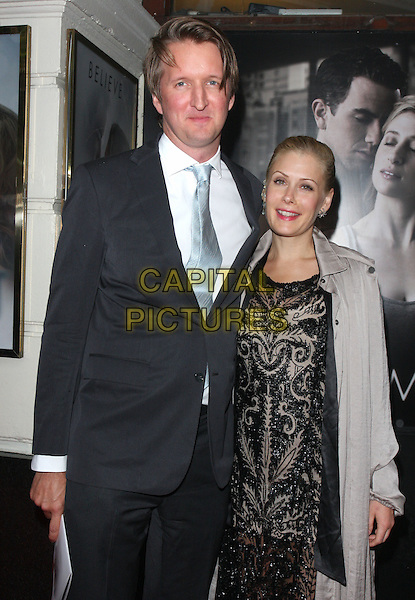 Tom Hooper & guest.'Ghost - The Musical' Opening Night at the Piccadilly Theatre, London, England..July 19th 2011.half length black suit white shirt blue tie print dress grey gray jacket.CAP/ROS.©Steve Ross/Capital Pictures