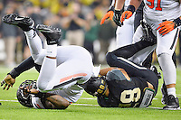 Oklahoma State defensive end Jimmy Bean (92) and Baylor running back Devin Chafin (28) land on the field after a play during second half of an NCAA football game, Saturday, November 22, 2014 in Waco, Tex. Baylor defeated Oklahoma State 49-28. (Mo Khursheed/TFV Media via AP Images)