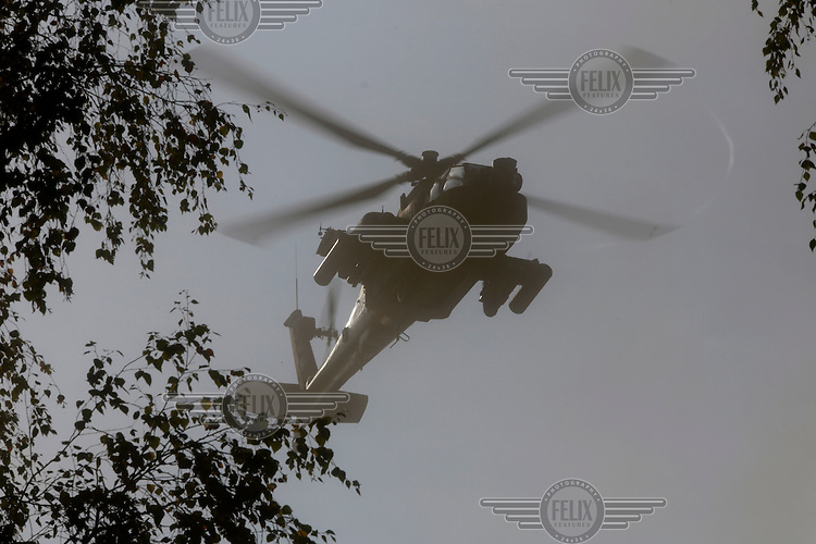 A Dutch  Apache  attack helicopter  during NATO exercise Noble Ledger in Norway. The NATO Response Force (NRF) is a multinational force made up of land, air, maritime and Special Operations Forces components. The exercise includes around 6500 soldiers from the USA, Germany, Netherlands, Denmark, Belgium and Norway. Photo: Fredrik Naumann/Panos Pictures