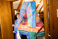 "Members of the congregation carry a quilt to mark the fourth year of the vigil at St. Frances Xavier Cabrini Church in Scituate, Mass., on Sun., May 29, 2016. Quilts marking each day of the 11 year vigil hung in the church throughout the vigil and were taken down after the final service. Members of the congregation have been holding a vigil for more than 11 years after the Archdiocese of Boston ordered the parish closed in 2004. For 4234 days, at least one member of Friends of St. Frances X. Cabrini has been at the church at all times, preventing the closure of the church. May 29, 2016, was the last service held at the church after members finally agreed to leave the building after the US Supreme Court decided not to hear their appeal to earlier an Massachusetts court ruling stating that they must leave. The last service was called a ""transitional mass"" and was the first sanctioned mass performed at the church since the vigil began."