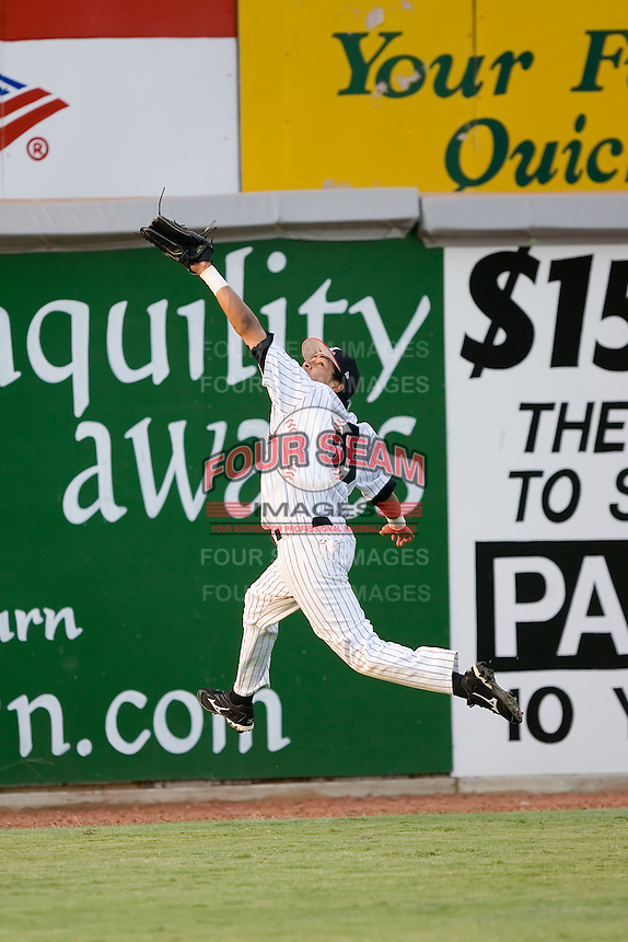 Hickory left fielder Albert Laboy (38) makes a leaping attempt to catch a fly ball versus West Virginia at L.P. Frans Stadium in Hickory, NC, Friday, August 24, 2007.