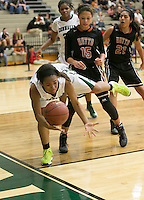 Connally's Jamia Miller tries to keep the ball inbounds Friday against Hutto.  The Hutto Hippos tripped up the Lady Cougars 54-42 at home.  (LOURDES M SHOAF for Round Rock Leader.)