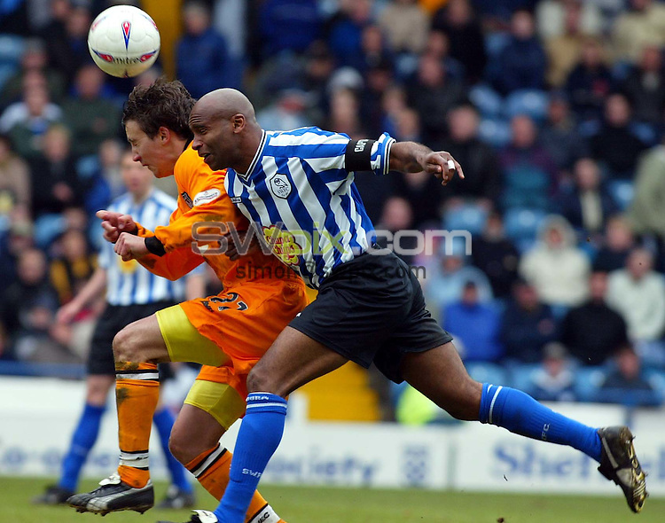 Pix, Shaun Flannery/SWpix. Nationwide League Division One..Sheffield Wednesday v Grimsby Town, 19/3/2003..COPYRIGHT PICTURE>>SIMON WILKINSON>>01943 - 436649>>..Grimsby's Michael Boulding beats Wednesday's Danny Maddix