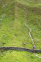 Northumberland,  England, UK.  Hadrian's Wall (Pennine Way) Footpath Ascends Walltown Crag.